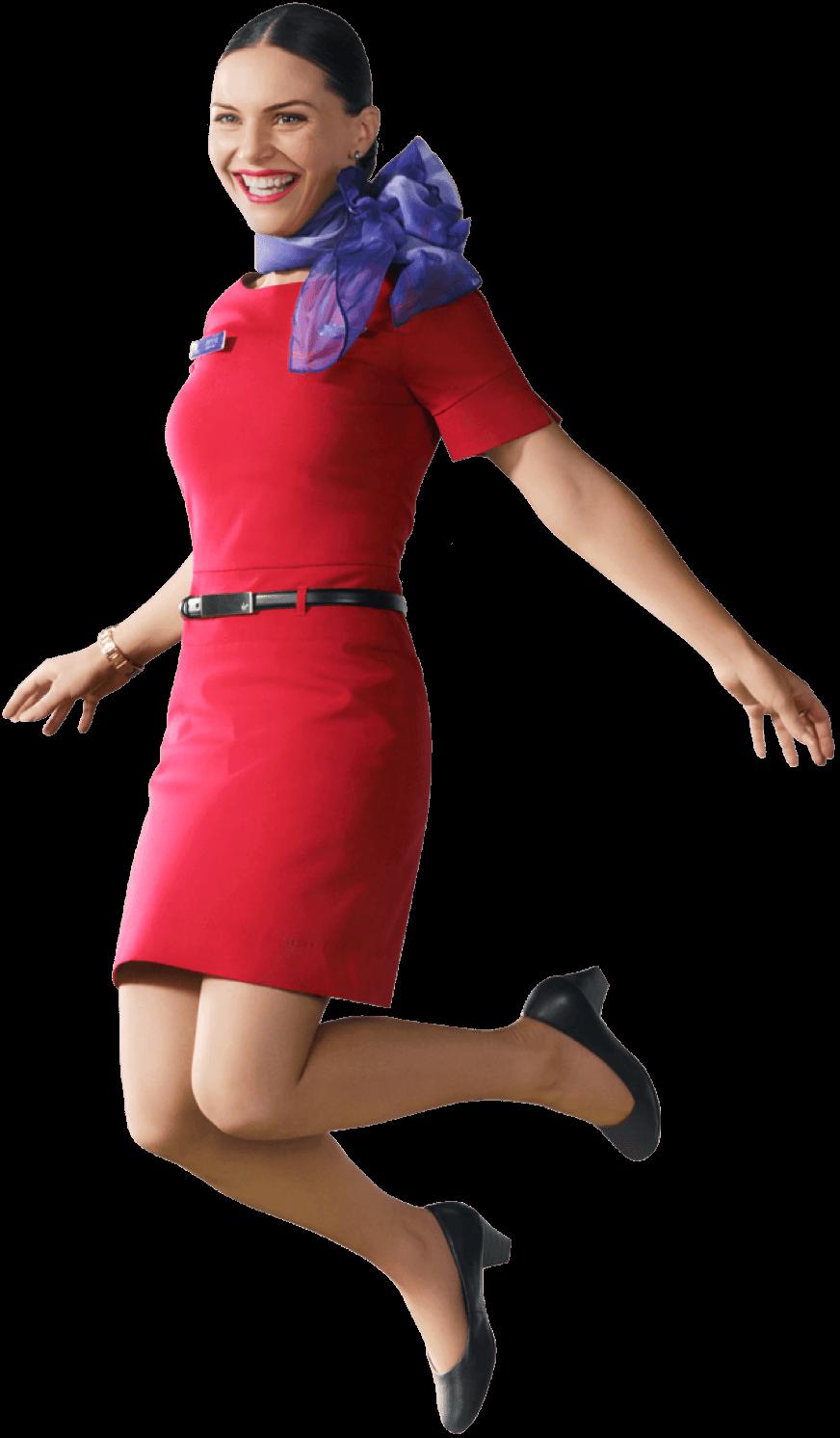 雲の上に浮かんでいるヴァージン・オーストラリア女性客室乗務員