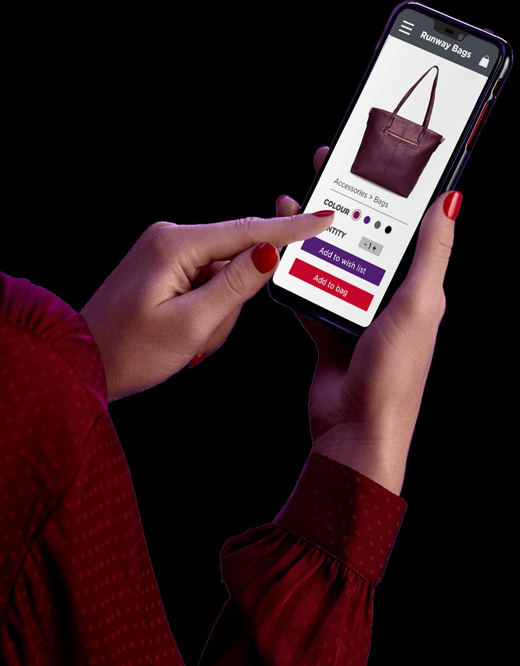 携帯電話を持ち、ヴァージン・オーストラリア アプリを見ている女性